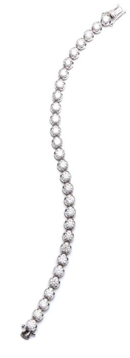 Sale 9260H - Lot 396 - An 18ct white gold diamond tennis bracelet; claw set with 29 round brilliant cut diamonds totalling approx. 10ct, SI2-P2/ I-K, to in...