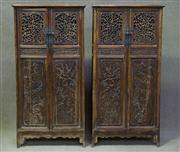 Sale 7968B - Lot 90 - A MAGNIFICENT PAIR OF CHINESE HUANGHUALI TAPERED PIERCED PANEL CABINETS