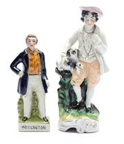 Sale 8873A - Lot 86 - A Staffordshire figure of Sir Wellington as Prime Minister and  gentleman with dog