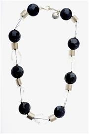 Sale 8315 - Lot 304 - A GEMSTONE BEAD NECKLACE BY JAN LOGAN; faceted onyx and rock crystal beads with silver spacing tubes and silver clasp, boxed.