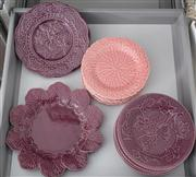 Sale 8470H - Lot 197 - A group of Portuguese leaf motif plates in aubergine (12) and pink (6)