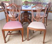 Sale 8515A - Lot 20 - A set of five Hepplewhite style shield back dining chairs, four in striped, one in blush pink upholstery