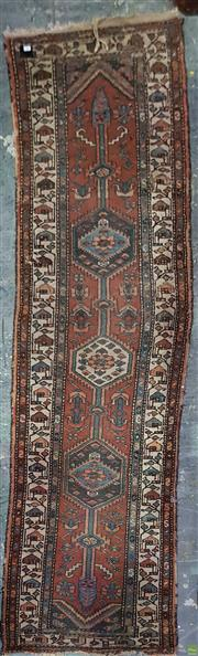 Sale 8648 - Lot 1087 - Probably Persian Hamadan Wool Runner, with triple medallion on axis with red field (losses mostly to ends)