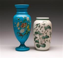 Sale 9119 - Lot 515 - Victorian painted blue glass vase (H:33cm) together with a milk glass example (H:24cm)