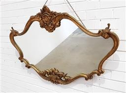 Sale 9162 - Lot 1045 - Rococo Style Gilt Mirror, of shaped oblong form with scroll border, surmounted by flowers - (damage, 83 x 127cm)