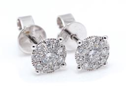 Sale 9260H - Lot 391 - A pair of 18ct white gold diamond cluster stud earrings; each set with a cluster of 10 round brilliant cut diamonds, total diamond w...