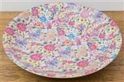 Sale 8530A - Lot 282 - A Qing style famille rose Mille-Fleurs plate, Yongzheng mark to the base, D 51cm