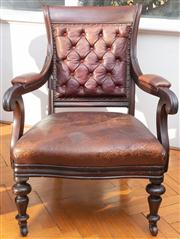Sale 8590A - Lot 43 - An Edwardian mahogany and button back leather upholstered elbow chair on turned legs and castors