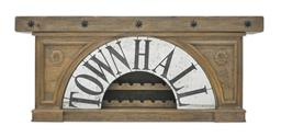 Sale 9140F - Lot 153 - Hardy Interiors original design, Townhall Grand Foyer Console. Solid Fruitwood finished in Smokehouse. Wine storage behind arch on s...