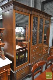 Sale 8282 - Lot 1032 - Late Victorian Maple & Co Ltd. Carved Mahogany Breakfront Wardrobe, with two Sheraton style carved panel doors, five drawers & flank...