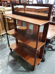 Sale 8993 - Lot 1088 - Victorian Mahogany Dumbwaiter, with low mirror back (mirror broken), of three tiers on turned supports and with mirror back
