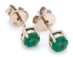 Sale 9083 - Lot 505 - A PAIR SOLITAIRE EMERALD STUD EARRINGS; each an approx. 0.34ct round cut emerald set in 18ct gold, wt. 1.28g.