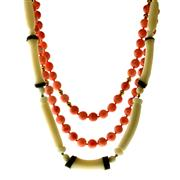 Sale 8065 - Lot 310 - TWO CORAL BEAD NECKLACES; a 78cm long strand of 7.5 - 8.5mm round pink coral beads, other a 45cm strand white bead and branch coral...