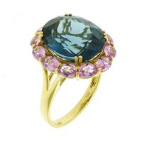 Sale 8221A - Lot 6 - 18ct Gold Topaz and Sapphire Cluster Ring; centering an oval cut estimated 9.3ct blue topaz, and twelve oval cut pink sapphires, Size N