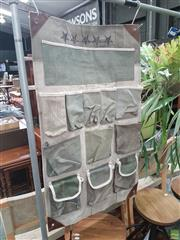 Sale 8310 - Lot 1079 - A Workshop Style Wall Hung Canvas and Leather 11 Pocket Storage Unit