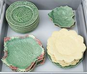 Sale 8470H - Lot 200 - A quantity of Portuguese colourful earthenware plates depicting pomegranates, cabbage leaves etc, in yellow and green (24 total)