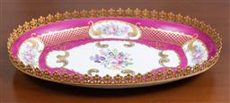 Sale 9140H - Lot 4 - A Limoges oval form dish with gilt rim, and with floral and gilt decorations, Length 32cm