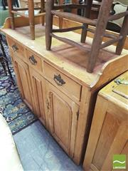 Sale 8428 - Lot 1029 - Rustic Possibly Antique Pine Sideboard, with gallery back, three drawers & two panel doors (missing plinth or legs)