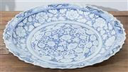 Sale 8530A - Lot 202 - A Yuan style blue and white plate decorated with ocean and floral, L 45cm