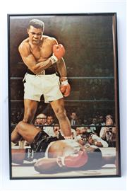 Sale 8733 - Lot 25 - Two Large Framed Photographs Of Ali, Including Showing Ali Signing Warren's Scrapbook (no glass)