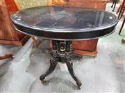Sale 8814 - Lot 1006 - Victorian Ebonised & Gilt Tilt-Top Occasional Table, with oval top, on birdcage base & outswept feet