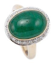 Sale 9083 - Lot 469 - AN EMERALD AND DIAMOND DRESS RING; rub set with an oval  cabochon emerald of approx. 6.30ct surrounded by 20 round brilliant cut dia...