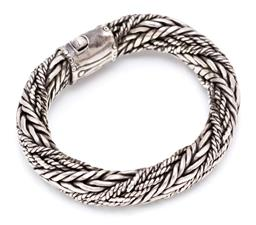 Sale 9164J - Lot 450 - A VINTAGE STERLING SILVER ROPE TWIST BANGLE; 13mm wide plaited design to unusual double sided lock clasp, stamped 925, length 15cm,...