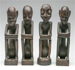 Sale 9209V - Lot 58 - A group of African seated timber figures (H: 31cm)