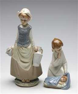Sale 9253 - Lot 197 - A Lladro girl with water jugs (H:28cm) together with a baby and guardian angel figural group (H:17.5cm)