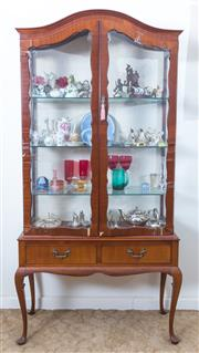 Sale 8515A - Lot 23 - A glass fronted arched display cabinet with two drawers, raised on cabriole legs, H 175 x W 80 x D 32cm, veneer needs attention