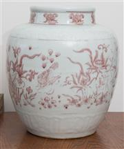 Sale 8530A - Lot 265 - A Ming style iron red jar decorated with lotus and ducks, Longqing mark to the base, H 30cm
