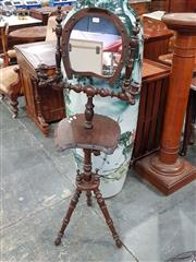 Sale 8814 - Lot 1045 - Late Victorian/ Edwardian Oak Shaving Stand, with horse-shoe shaped mirror and shelf, on turned supports & legs