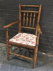 Sale 8976 - Lot 1047 - 19th Century Provincial Oak Armchair, with turned spindle back, rush seat (minor flaws) with loose cushion & on turned legs with str...
