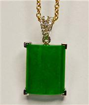 Sale 8036A - Lot 328 - A JADE AND DIAMOND PENDANT; set in 18ct white gold with 15 x 12mm cabochon jade on a bale set with 17 round brilliant cut diamonds o...