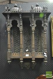 Sale 8359 - Lot 1006 - Indo-Islamic Carved Fruitwood Hanging Shrine, with a four column niche having pierced backing panels, surmounted by two domes, flank...