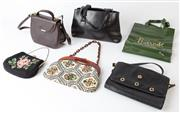 Sale 8550F - Lot 227 - A group of six bags including a black Oroton leather hand bag, a brown Oroton leather shoulder bag, a Firina black leather envelope...