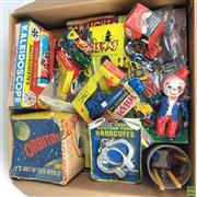 Sale 8559A - Lot 83 - Box of Vintage 50s toys incl. Orbitoy Satellite Space Spinner, Lonestar Spud-matic diecast guns, kaleidoscope, gyroscope, mostly...
