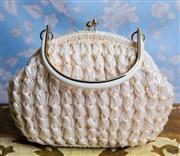 Sale 8577 - Lot 81 - A vintage 1960s white raffia weave basket bag featuring white lucite handle with gold accents, H 19 x W 26cm, Condition: Excellent