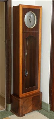 Sale 9066H - Lot 13 - An English art deco style longcase clock with walnut veneered base with dial with silvered Arabic numerals by Enfield. H 197cm W 57c...
