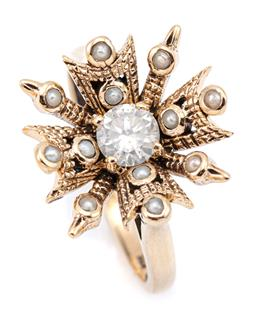 Sale 9083 - Lot 515 - A 9CT GOLD DIAMOND AND PEARL DRESS RING; snowflake design centring a round brilliant cut diamond of approx. 0.41ct surrounded by see...