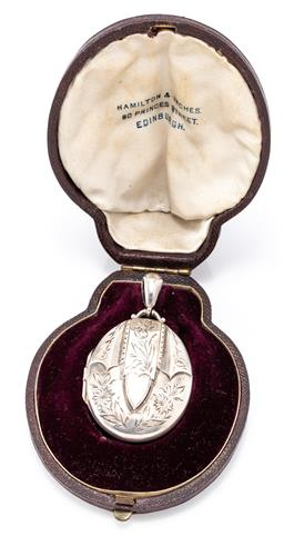 Sale 9180E - Lot 141 - A cased sterling silver locket pendant with floral motif