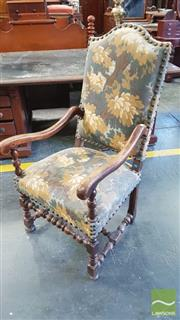 Sale 8402 - Lot 1053 - Louis XIV Style Walnut Armchair with tapestry camel back and seat on turned legs and stretchers.