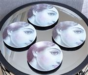 Sale 8703A - Lot 46 - A set of four glass Fornasetti plates, diam 14.5cm