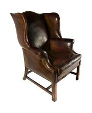 Sale 8716A - Lot 38 - A good vintage distressed leather Georgian style wing back armchair, slight scuff marks & cracking/crazing to arms and side commensu...
