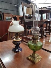 Sale 8868 - Lot 1098 - Edwardian Brass Kerosene Lamp & Electric Porcelain Lamp, the former with green glass font, the other with white glass shade