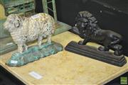 Sale 8312 - Lot 1004 - Two Iron  Door Stops of Sheep & Lion