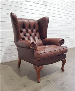 Sale 9121 - Lot 1062 - Leather wing back armchair on cabriole legs (h:100 w:83 d:88cm)