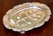 Sale 7997 - Lot 61 - A LARGE EDWARDIAN SILVER PLATE CARVING DISH WITH DRAINING TREE AND BROAD GRAPE ENCRUSTED BORDER