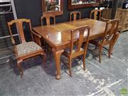 Sale 8566 - Lot 1297 - Carved Maple Dining Setting incl. Extension Table & Set of Five Dining Chairs