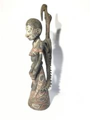 Sale 8600A - Lot 84 - Papua New Guinean carved statue painted with natural pigments, H 74cm.
